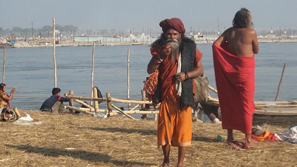 Sadhus dressing up after bath in Triveni Sangam